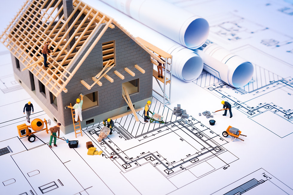 building house on blueprints with worker