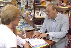 Anton signing books.png