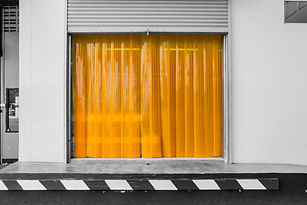 Warehouse gate loading area with PVC strip curtain or plastic strip doors..jpg
