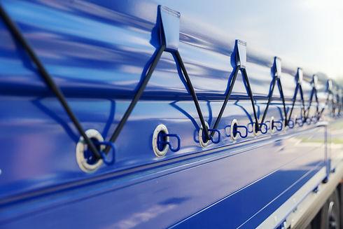 detail of blue tarp on the truck trailer