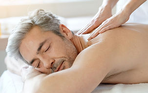 Man relaxing on massage table receiving