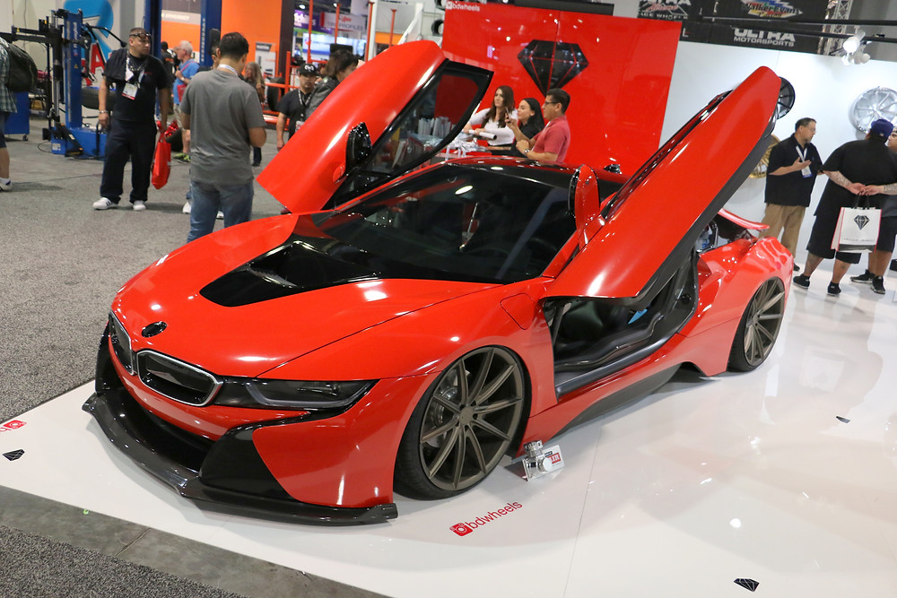 red bmw i8 bagged with newest vorsteiner carbon fiber body kit