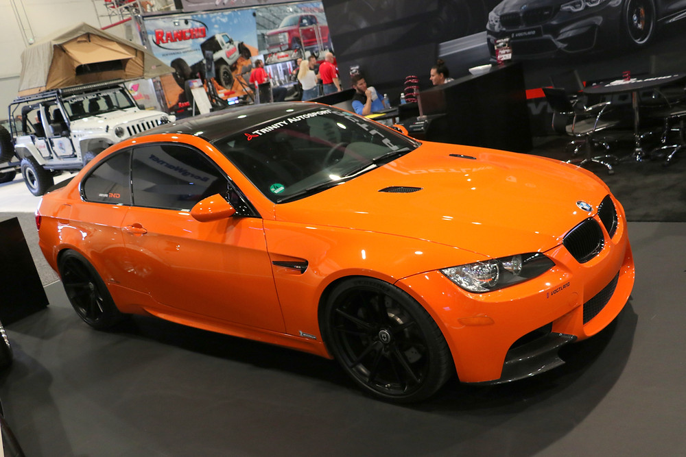 E92 BMW M3 coupe orange with carbon fiber parts at SEMA 2017