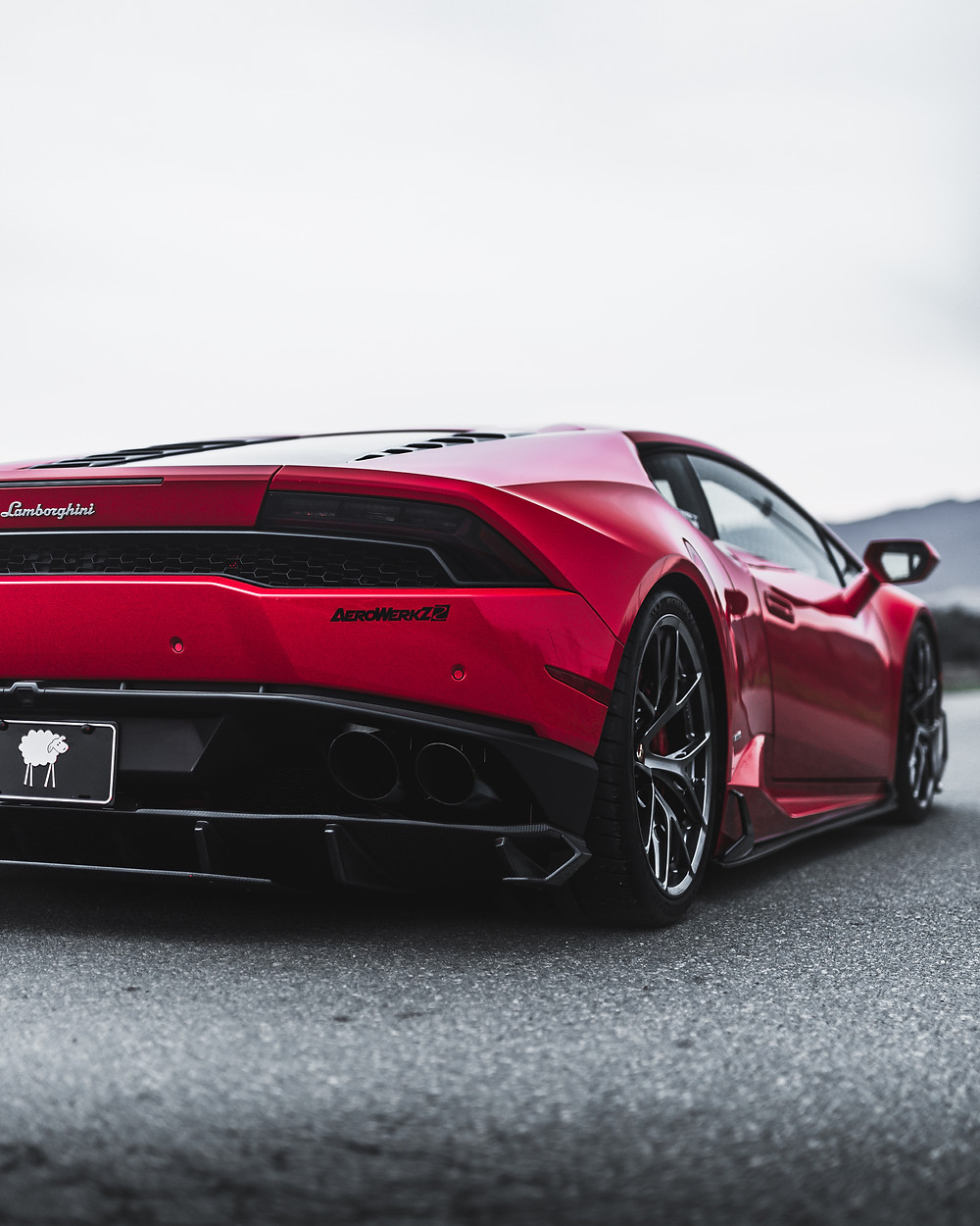 rosso red lamborghini huracan with bbs F1R 20 inch wheels in diamond silver and lowered with novitec springs and future design carbon fiber body kit