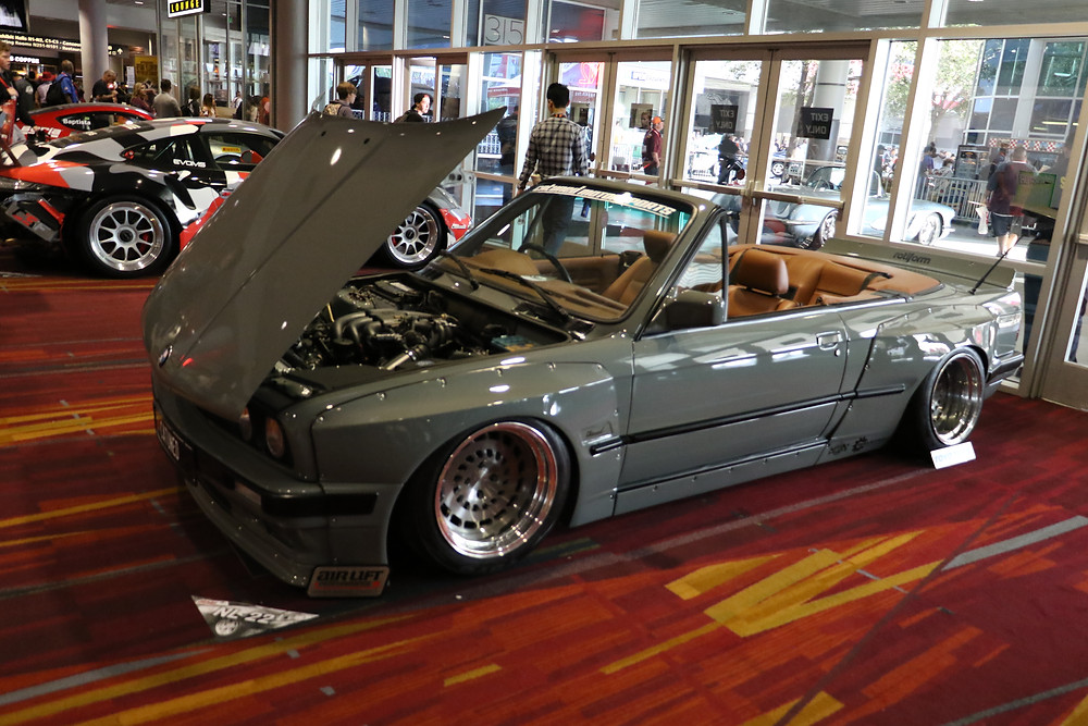 Pandem wide body on a grey E30 cabriolet convertible at SEMA 2017