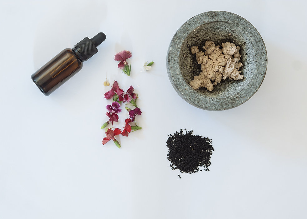 black-seeds-fresh-flowers-a-bottle-and-a