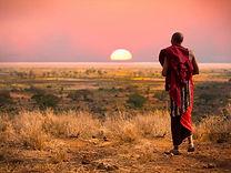 Masai-Man-watching-sunset--Africa-Overla