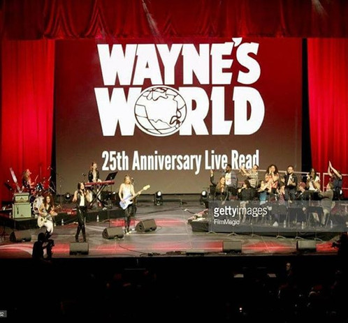 """Wayne's World is one of my favorite movies and I had the opportunity to perform music from the movie during Comedy Central's Collossal Clusterfest at Bill Graham Civic Auditorium in front of tens of thousands of people. Also on stage performing was Tia Carrere who sang a couple of songs with us, and a number of Comedy Central comedians. That's me playing bass underneath the words """"25th Anniversary."""""""