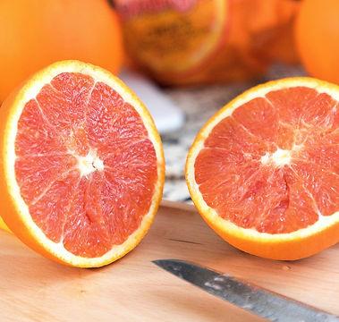 orange%20fruit%20on%20brown%20wooden%20table_edited.jpg