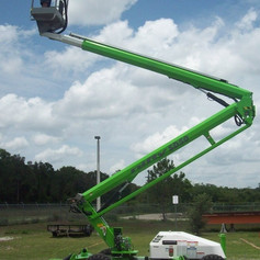 Our all-terrain lift can work on lights in hard-to-reach areas like tennis courts and also is great for right-of-way road clearing
