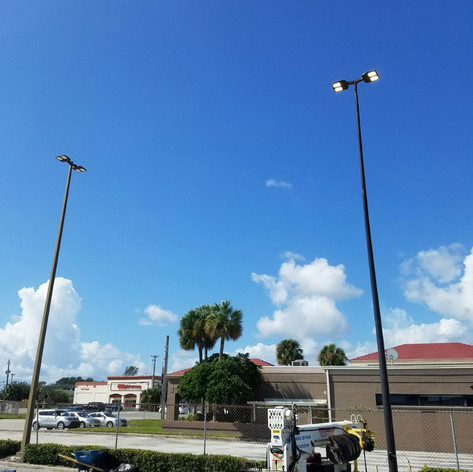 Installation of new light poles and LED fixtures according to customer's photometric