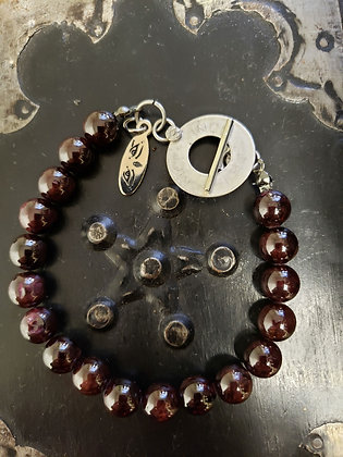 A garnet bracelet with an old Indian coin clasp.