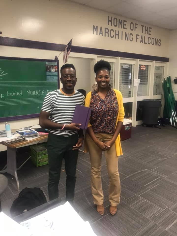 Band Director receives award from guidance counselor