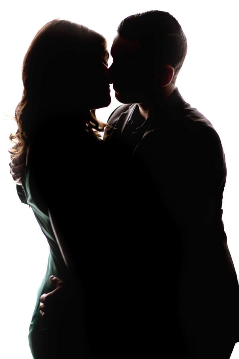 silhouette of kissing couples photo