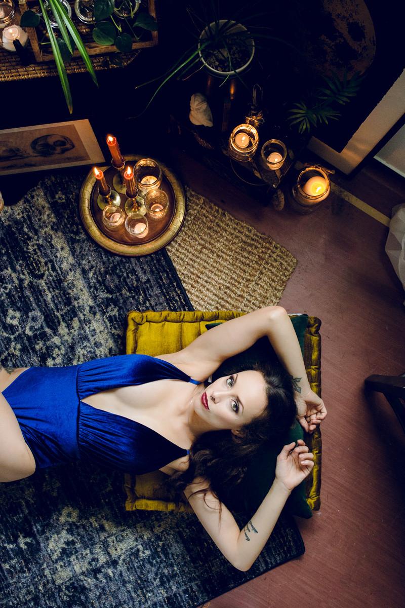 witchy boho boudoir in blue velvet bodysuit for editorial style photoshoot