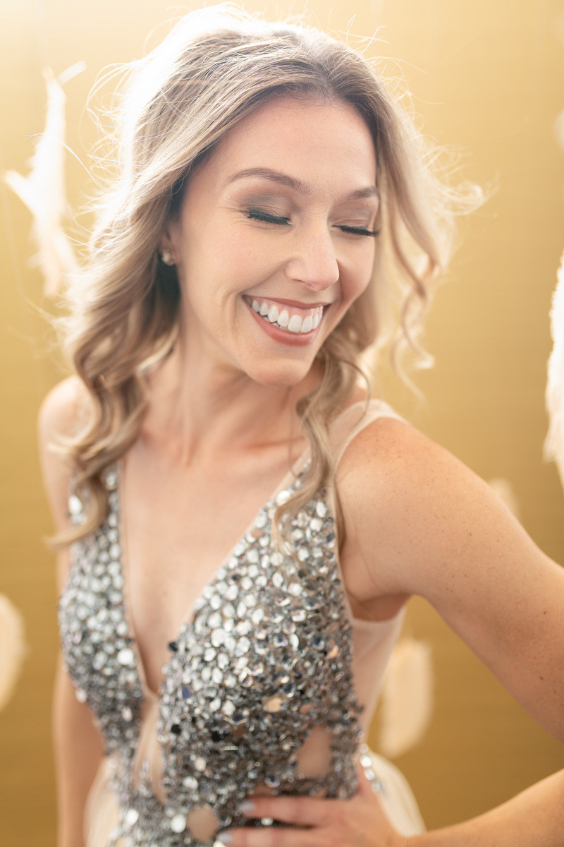 laughing blonde in editorial style portrait with rhinestone and tulle dress pdx