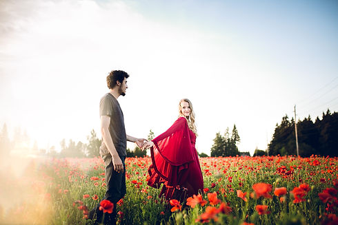 sunset couples photos in a field of red poppy flowers