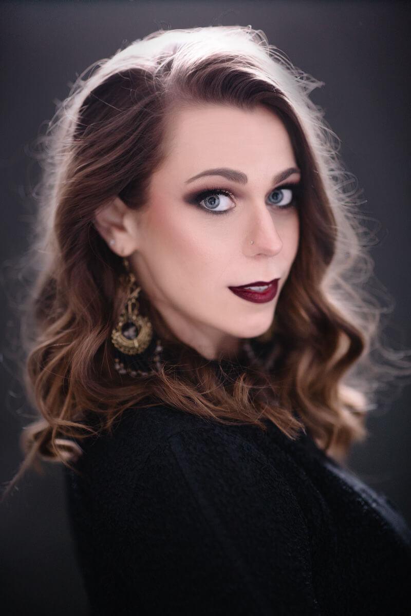 moody and dark headshot photo of brunette
