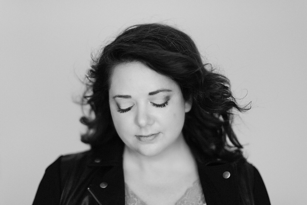 black and white headshot of brunette in leather jacket in vancvouer wa