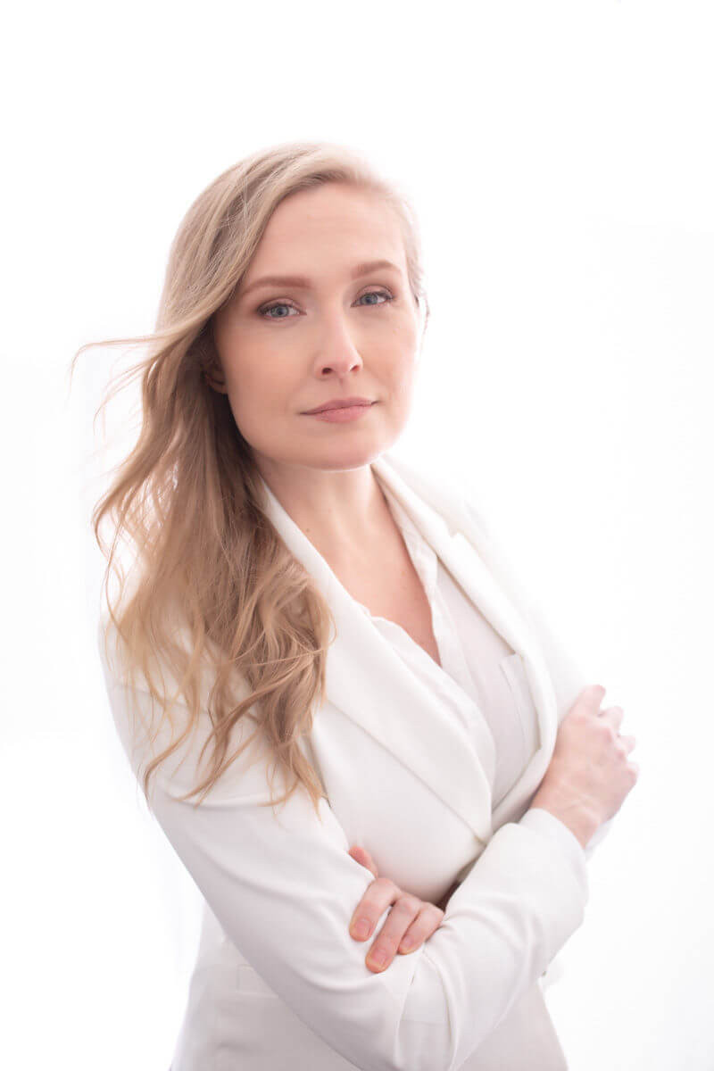 strong professional business photo of blonde in white suit on white background