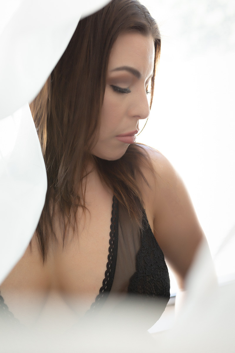 bright high key backlight boudoir in black bodysuit washington