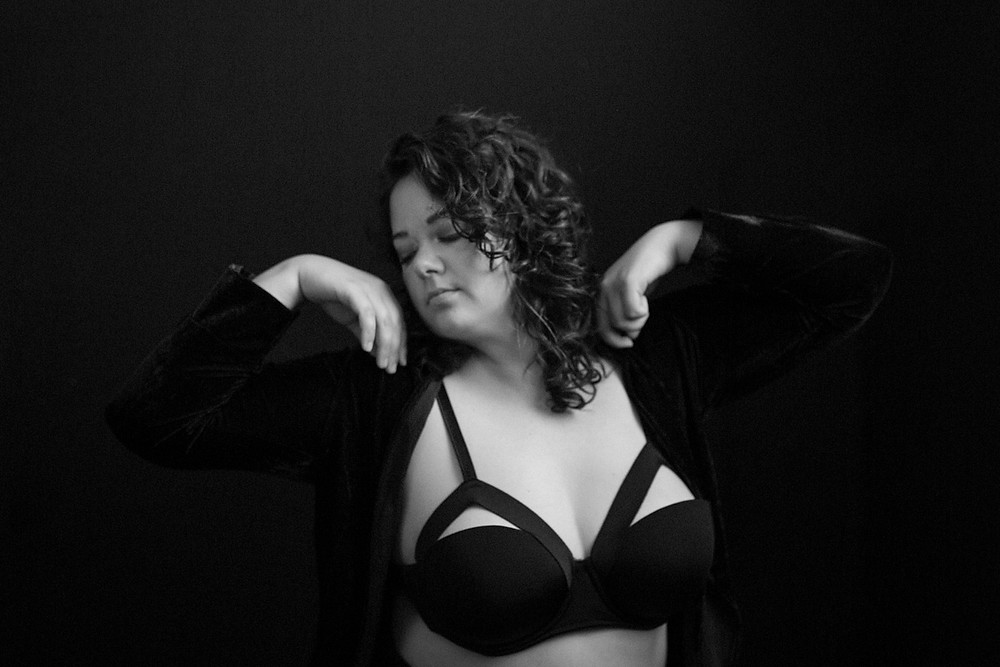 moody editorial boudoir portrait of woman with curly hair in vancouver wa