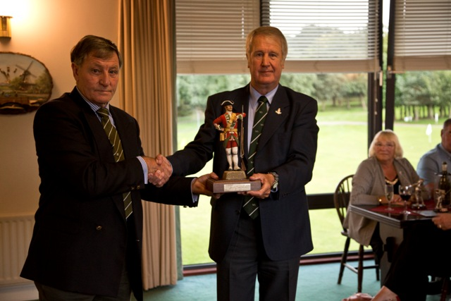 Peter Curtis, receiving the new perpetual champions trophy. The trophy will show the last 10 years w