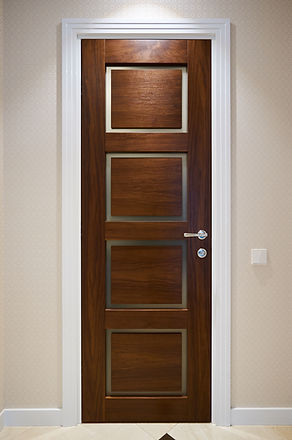 The door is made of walnut wood in a cla