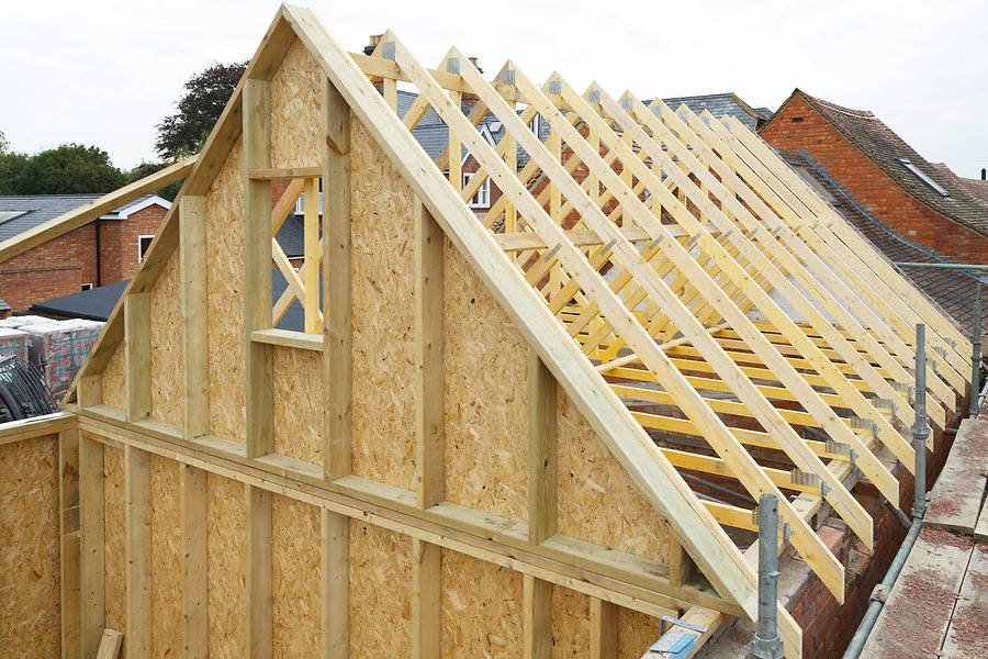 Gable and wooden roof trusses to a timbe