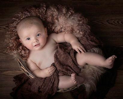 Newborn photo brown background