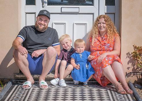 family-doorstep-seated-photo