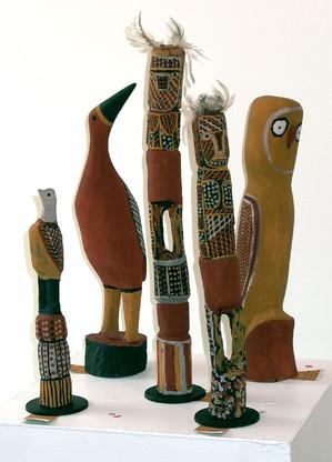 Left to right: John Patrick Kelatumama 663-05 'Jilardi' 2005 Carving  52cm (h)  Immaculata Tipiloura 18-06 'Jurrukukuni' 2006 Carving  48cm (h)  Carmelina Puantulura  676-05 'Japarra' 2005 Carving  58cm (h)  Carmelina Puantulura  675-05 'Wayayai' 2005 Carving  49.5cm (h)  Carmelina Puantulura  677-05 'Bima' 2005 Carving  37cm (h)