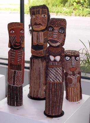 Left to right:  Carmelina Puantulura Carving  72.5cm (h)  Immaculata Tipiloura  727-05 'Murntankala' 2005 Carving  41.5cm (h)  Tess Tipungwuti 726-05 'Wayayi' 2005 Carving  66.5cm (h)  Tess Tipungwuti  19-06 'Bima' 2006 Carving  65cm (h)