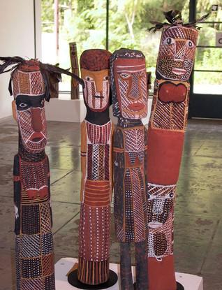 Left to right:  Aymard Tungatalum  787-06 'Head' 2006 Carving  90cm (h)  Tess Tipungwuti  517-05 'Female Figure' 2005 Carving  86cm (h)  Tess Tipungwuti 986-06 'Bima' 2006 Carving  89cm (h)  Carmelina Puantulura  637a-05 'Female Figure' 2005 Carving  100cm (h)