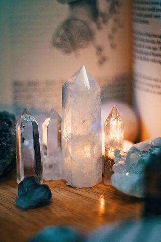 Crystals on Wooden Table_Seva Reiki.jpg