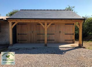 Two Bay Oak Frame Garage by Cheshire Oak Structures Ltd