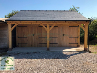 Two Bay Oak Frame Garage by Cheshire Oak Structures Ltd