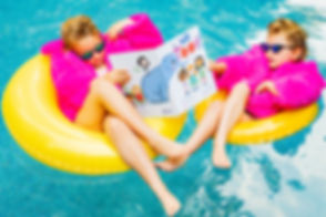 Girls Reading We Toot in the Pool