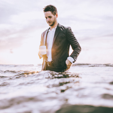 Grant Stemler in a suit in the ocean
