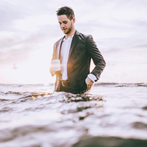 Grant Stemler in a suit in the ocean