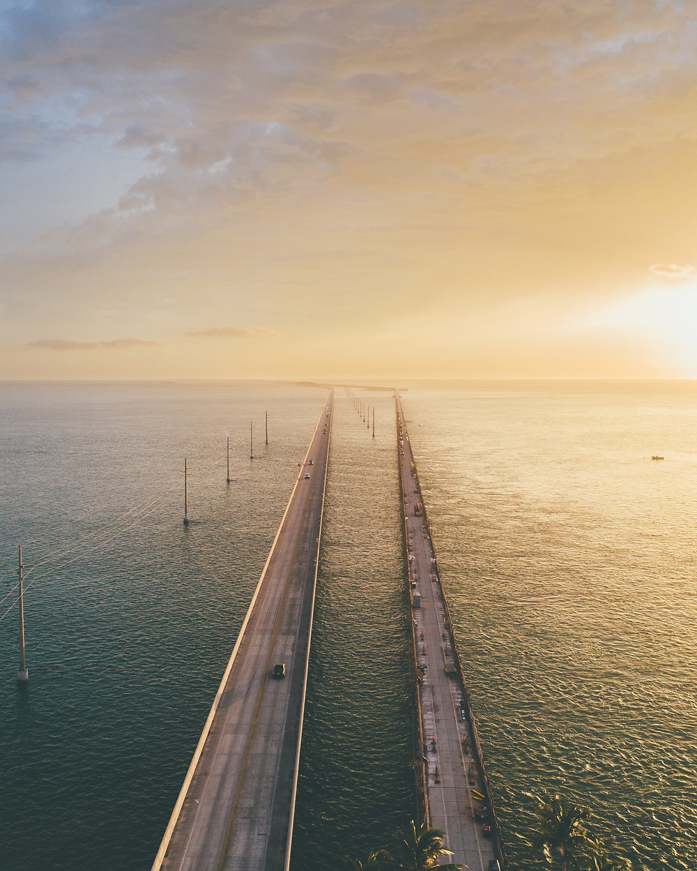 Drone picture of a bridge at sunset in the florida keys by pierce gainey