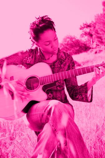 teenage girl paying guitar