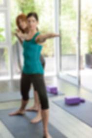 Madi providing yoga instruction