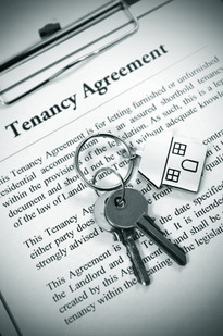 Tenancy agreement and key with symbolic