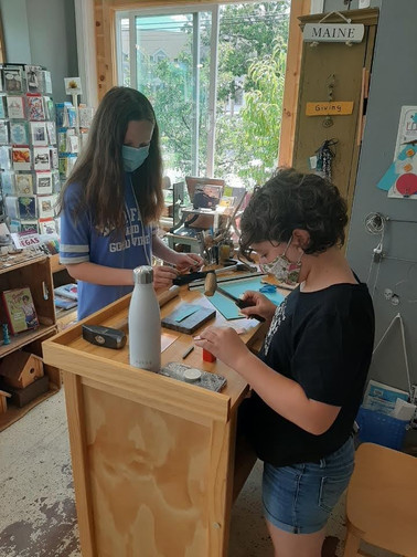 Young artists participate in a jewelry workshop with Maine CoLab