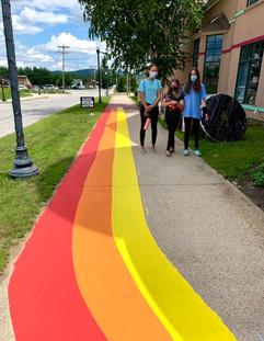 working on rainbow walk way.jpg