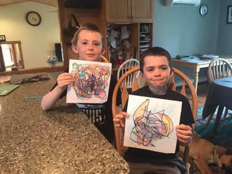Young Artists Showing Off Their Work