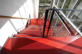 Red safety flooring on stairs