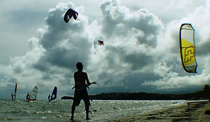 kid flying kite on the beach