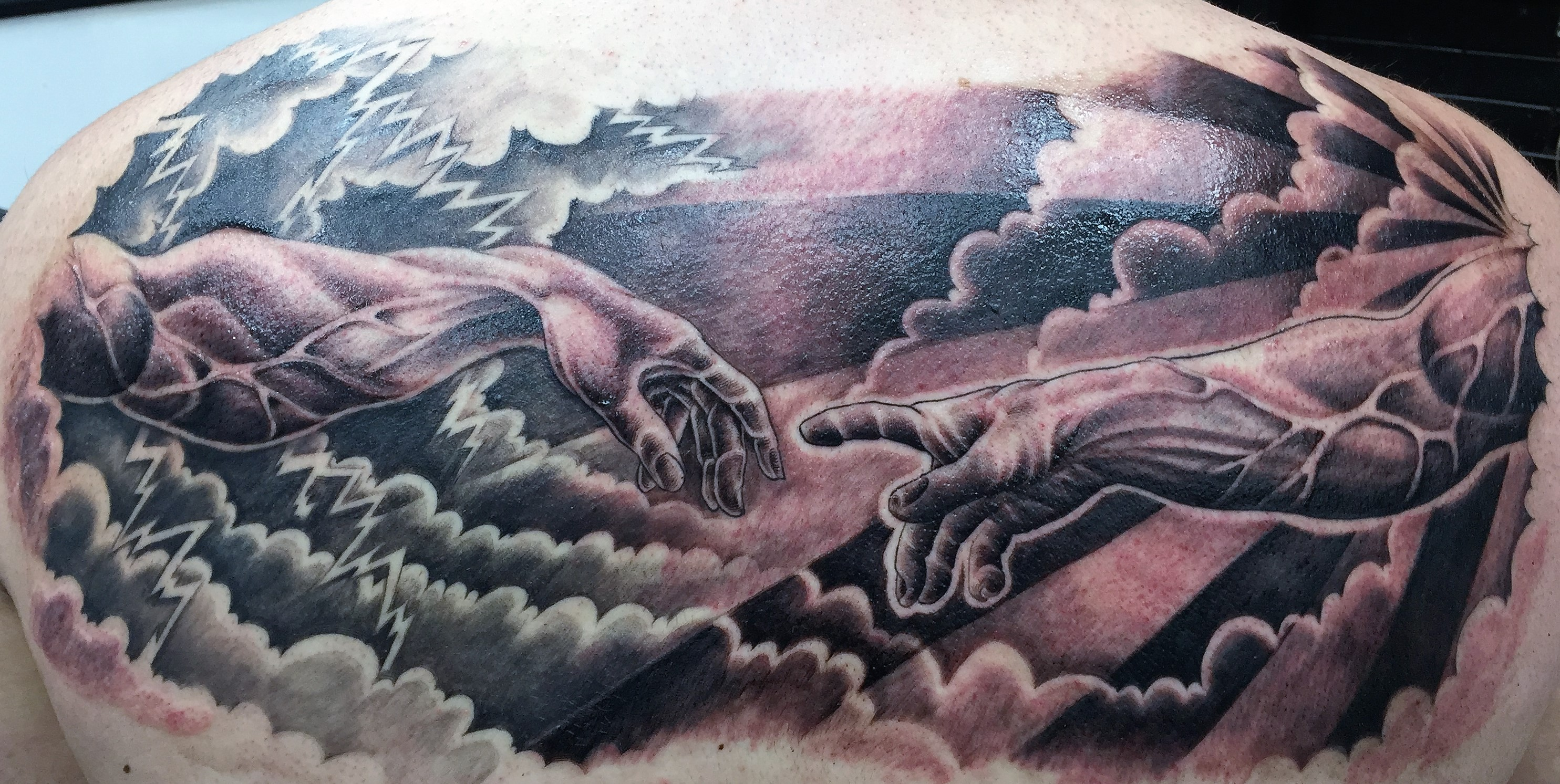 creation of man tattoo